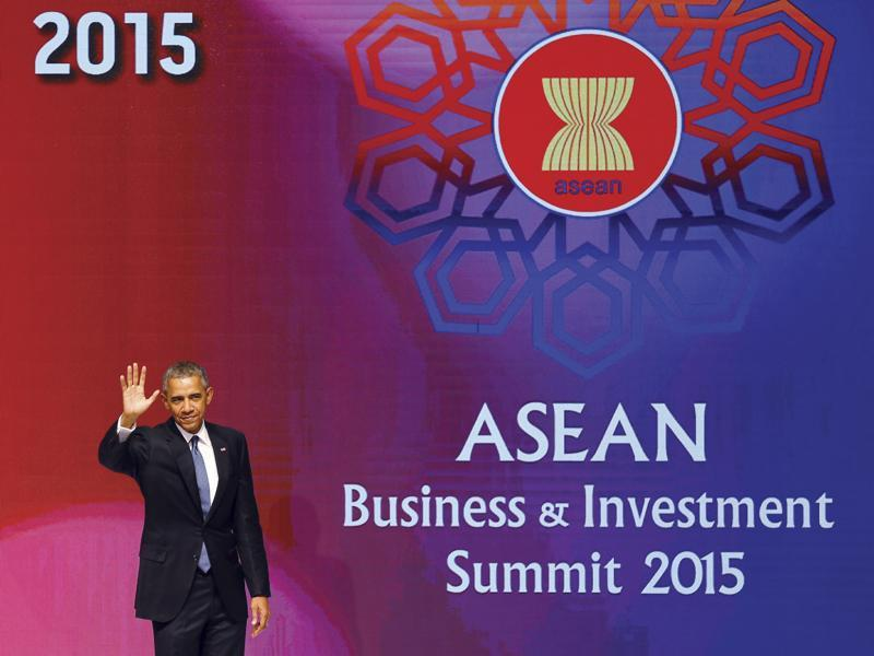 US President Barack Obama waves after giving a speech at the ASEAN Business and Investment Summit. (AP)