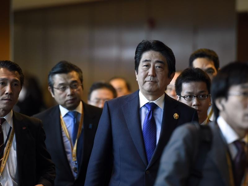 Japan's Prime Minister Shinzo Abe arrives to take part in the ASEAN Plus Three (Japan, China and South Korea) meeting, part of the 27th ASEAN Summit in Kuala Lumpur.  (AFP)