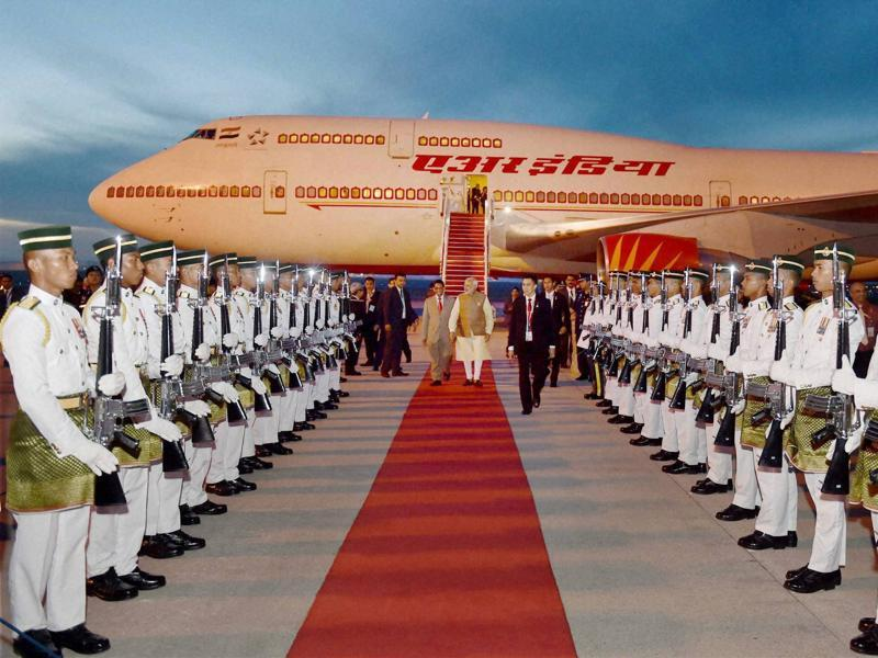 PM Modi inspects a guard of honour on his arrival at Bunga Raya Kuala Lumpur International Airport in Malaysia.  (PTI)