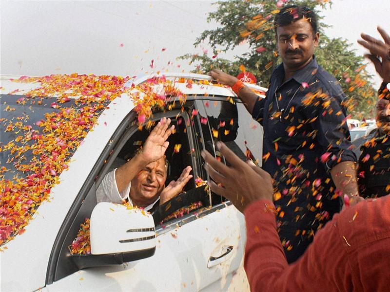 Supporters shower flowers on SP chief Mulayam Singh Yadav as he arrives at a programme to celebrate his 77th birthday in Saifai on Saturday. (PTI Photo)
