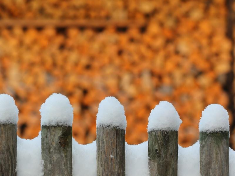 Snow covers a fence in Kaufbeuren, southern Germany, after first snow of the season fell in the region.  (AFP)