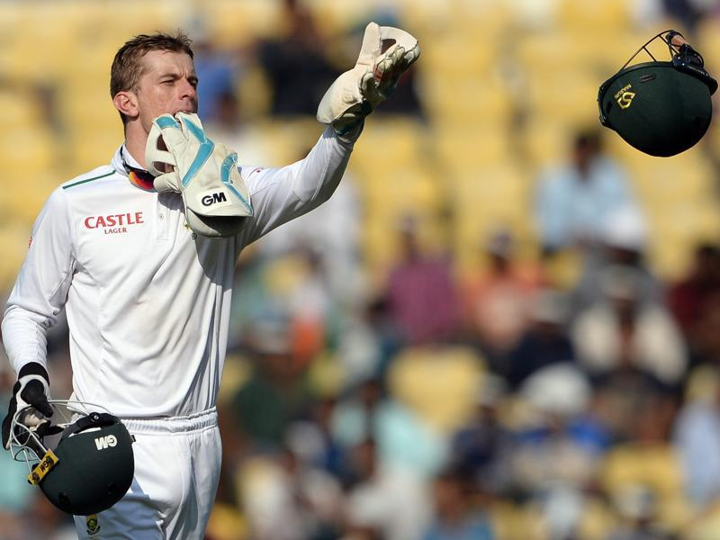 South Africa's wicketkeeper Dane Vilas throws a helmet to a teammate. (AFP Photo)