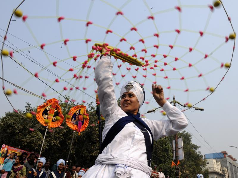 Sikhs display their 'Gatka' skills, a form of Sikh martial art, during a religious Gurupurab procession, in New Delhi. (Sonu Mehta/ HT Photo)
