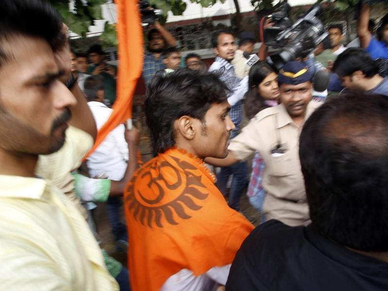 A Hindu Sena activist shouts slogans during a protest outside Aamir Khan's residence in Mumbai on Tuesday, Nov. 24, 2015. Aamir has earned the ire from various groups for his comment on rising intolerance in the country and that his wife has discussed the possibility of leaving the country.  (AP)