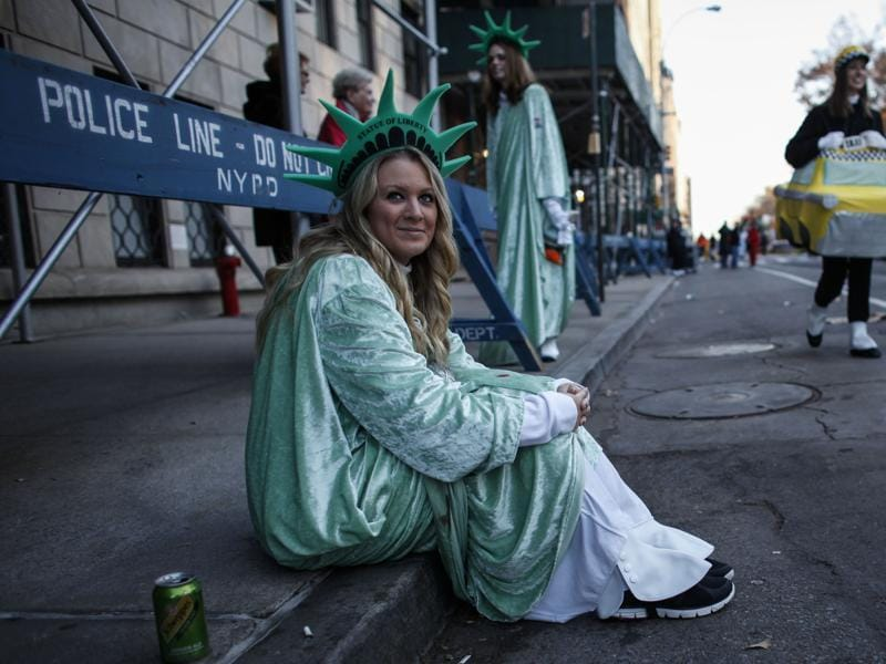 A woman dress up as Statue of Liberty waits before the Annual Thanksgiving Parade in New York City. (AFP)