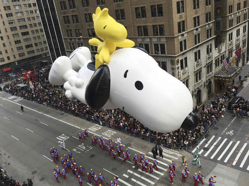 A float depicting the animated Peanuts characters Snoopy and Woodstock proceeds along 6th Avenue as spectators watch during the 89th Macy's Thanksgiving Day Parade in the Manhattan borough of New York on Thursday.  (REUTERS)