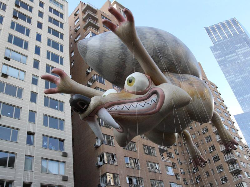 Ice Age's Scrat balloon makes its way across New York's Central Park South during the Macy's Thanksgiving Day Parade, Thursday. (AP)