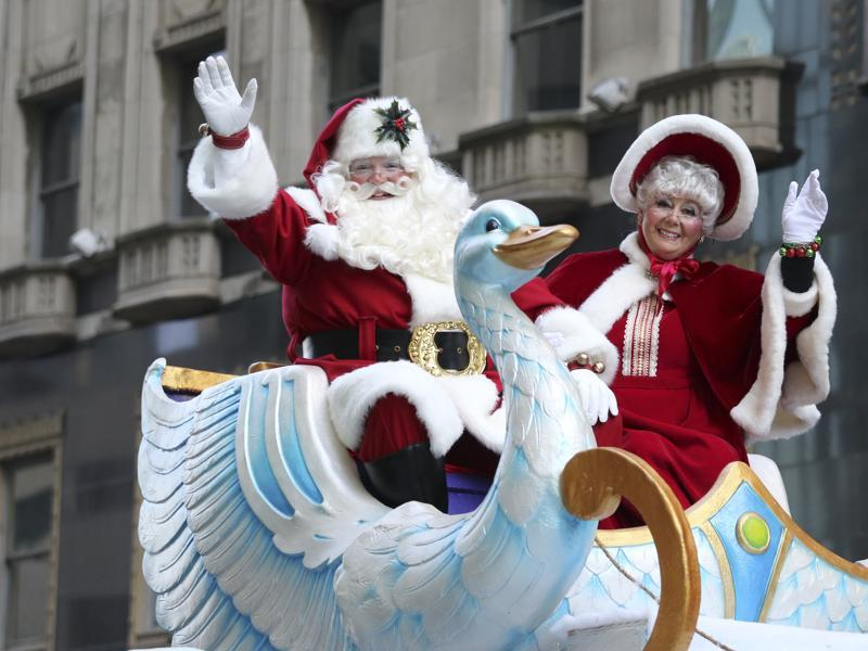A couple dressed as Santa Claus and Mrs. Claus wave to spectators during the 96th annual Thanksgiving Day Parade, Thursday in Philadelphia.  (AP)