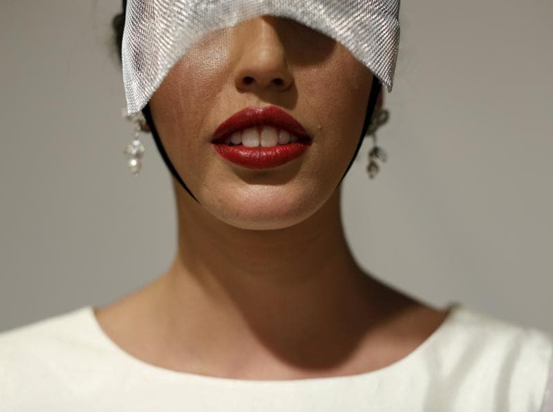 A model waits backstage before presenting a creation by Juan Vara at the show.  (REUTERS)