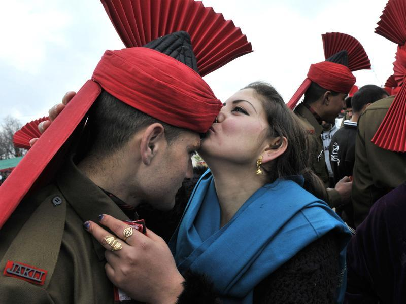A new recruit's relative kisses him after the passing out parade at an army base on the outskirts of Srinagar. (Waseem Andrabi/HT Photo)