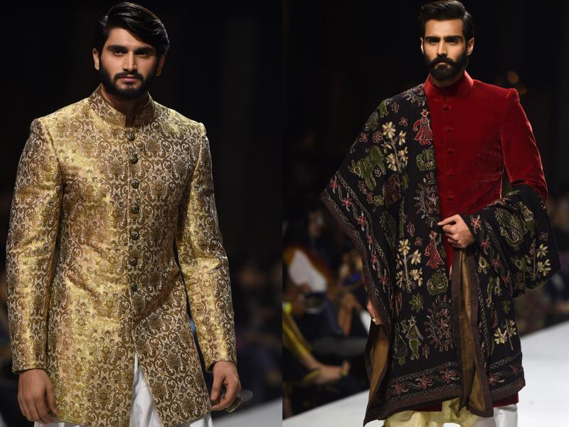Two male models sport designer Obaid Shiekh's creation on the ramp during the Karachi show.   (AFP )