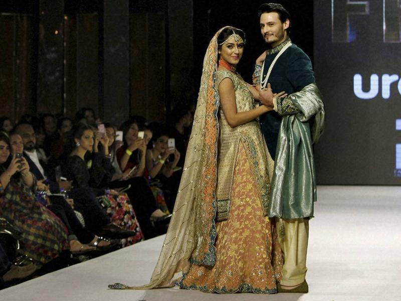 Models wearing a collection by Pakistani designer Wardha Saleem in Karachi on November 30. More than 20 designers showcased their creations in the 3-day Fashion Pakistan Week Winter Festive 2015. (AP)