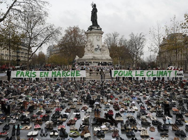Hundreds of pairs of shoes are displayed at the Place de la Republique, in Paris, as part of a symbolic and peaceful rally called by the NGO Avaaz