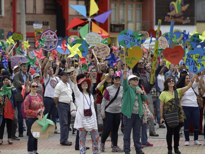 Protesters take part in a silent march calling for ambitious action to tackle climate change, in Bogota, Colombia, Sunday.  (AP Photo)