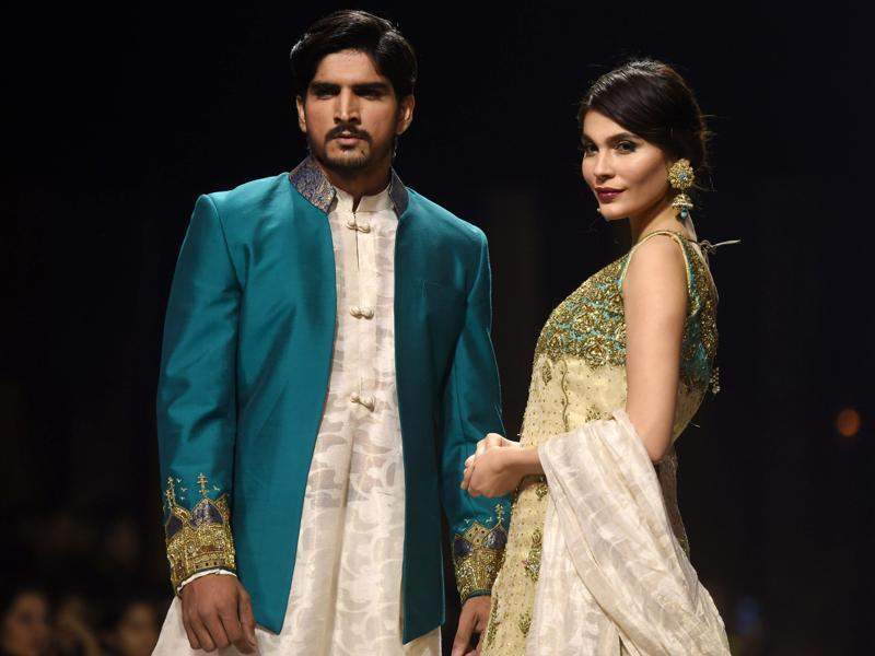 Models present creations by designer Obaid Shiekh during the Karachi show.  (AFP)