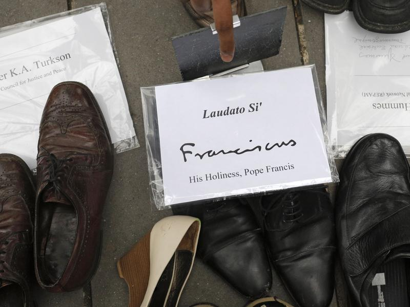 Pope Francis' shoes are seen in the middle of hundreds of pairs of shoes displayed at the Place de la Republique, in Paris, as part of a symbolic and peaceful rally called by the NGO Avaaz after French police detained hundreds of protesters and banned demonstrations, citing security issues after the November 13 terrorist attacks. (AP Photo)