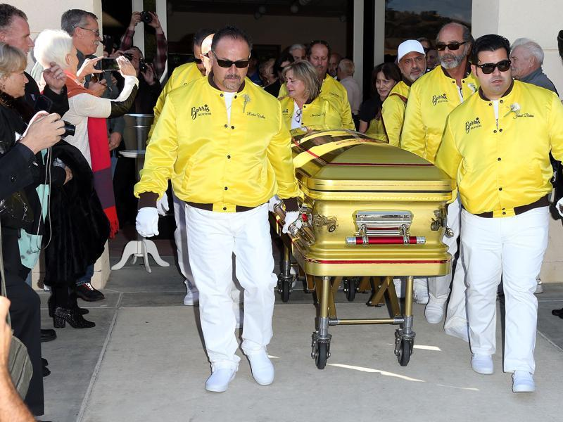 Pallbearers Richie Valles (L), Joji Barris (C) daughter, and son Jared Barris (R) during George Barris Celebration of Life Memorial and Burial Service at Forrest Lawn Memorial on Saturday.  Barris is the man responsible for designing the iconic and much-loved '66 Batmobile. (AFP)