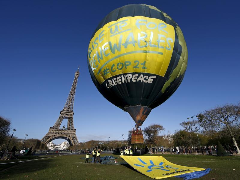 Greenpeace activists fly a hot air balloon depicting the globe next to the Eiffel Tower, in Paris. (Reuters Photo)