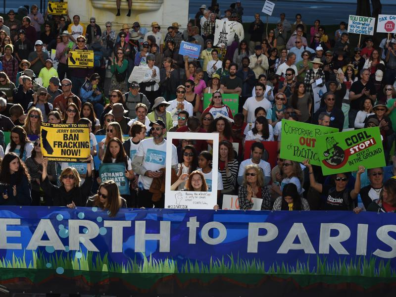 Environmental activists and supporters, during a rally, call for action on climate change in Los Angeles, California, a day before the start of the COP21 conference in Paris. Some 150 leaders will attend the start of the Paris conference. (AFP Photo)