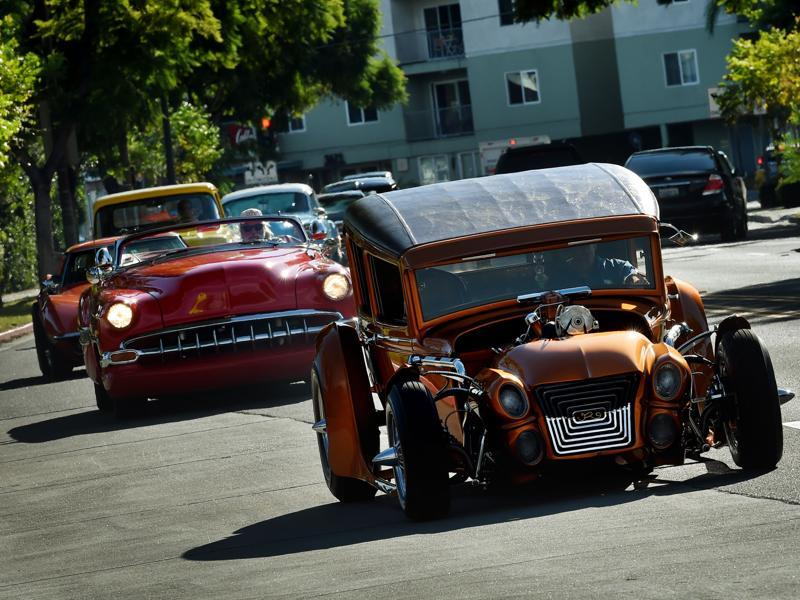 Mourners in hot rods and custom cars arrive for the funeral service of legendary Hollywood film and television car builder George Barris. His casket was inspired by his most famous creation, Batmobile. (AFP)