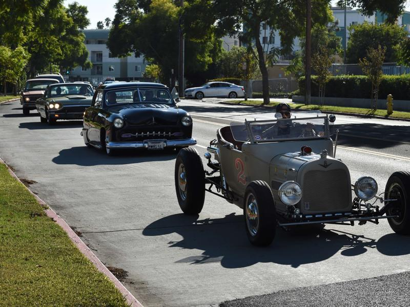 Mourners in hot rods and custom cars arrive for the funeral service of legendary Hollywood film and television car builder George Barris. He has also created vehicles for the TV shows Knight Rider, The Munsters and The Beverly Hillbillies and the films North by Northwest and Teenage Confidential. (AFP)