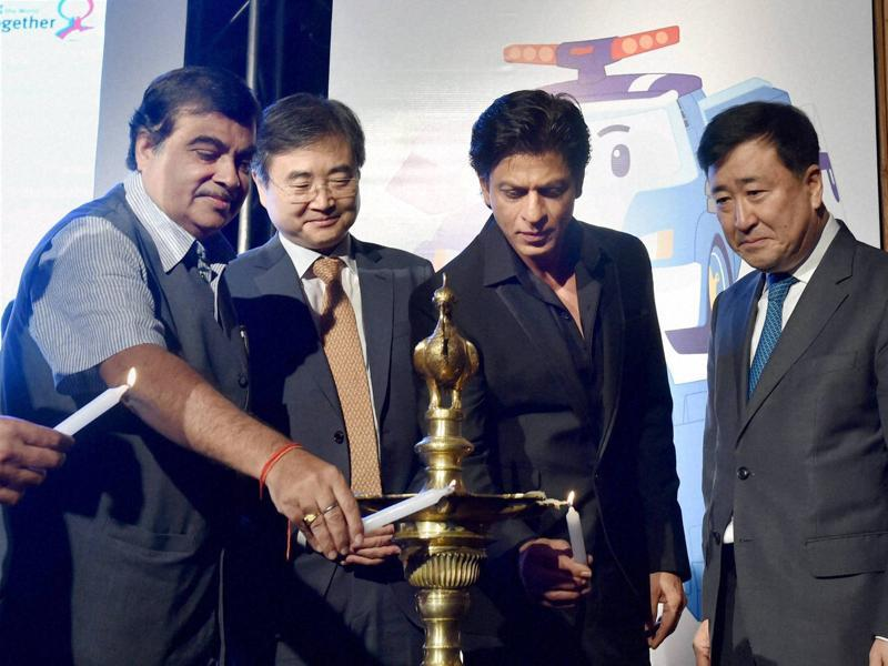 Another day at work for SRK, another diya to light up, another picture to pose for.  (PTI)