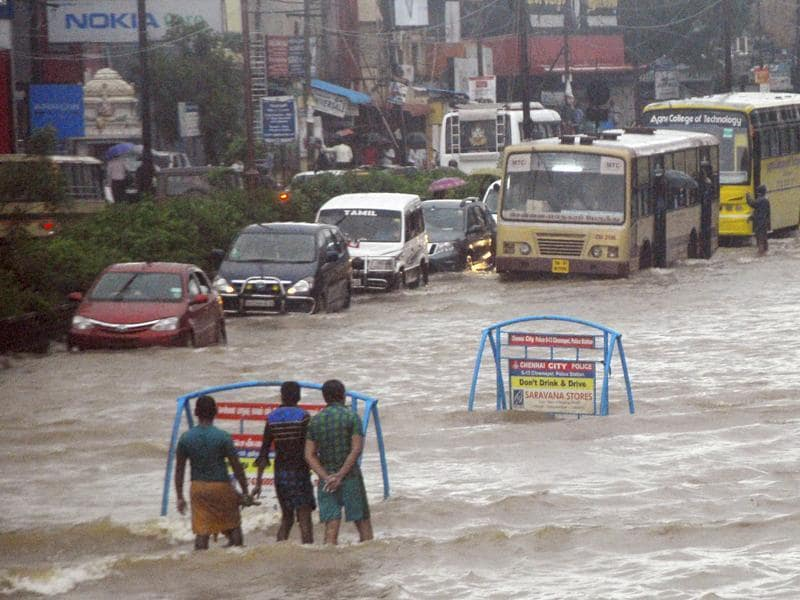 Vehicles wade through a water logged road following heavy rains in Chennai.  (HT Photo)