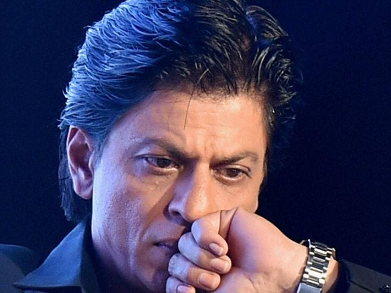 Why did I decide to speak on intolerance? I was happily enjoying my stardom, then why, oh why? That's what Shah Rukh Khan seems to be asking himself at the 'Safe Move-Traffic Safety Campaign' in New Delhi on Monday.  (PTI)