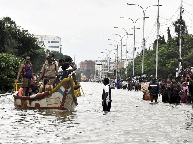 People are rescued from their waterlogged houses during heavy rains in Chennai on Wednesday.  (PTI)