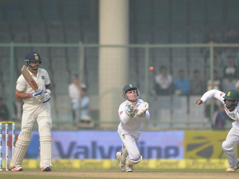 Dane Vilas takes the catch to dismiss Virat Kohali off the bowling of Dane Piedt. (Vipin Kumar/HT Photo)