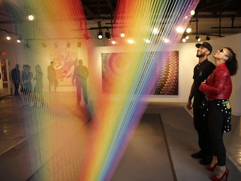 Musician Alicia Keys (right) and her husband hip hop Swizz Beatz look at an installation by artist Gabriel Dawe at Casa Bacardi's art fair, Thursday, December 3, 2015 in Miami. This no-commission art fair, Miami Art Week and numerous other satellite fairs and exhibitions take place the first week of December in conjunction with Art Basel Miami Beach. (AP)