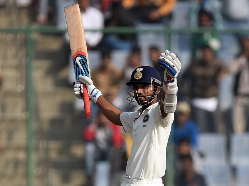 India's Ajinkya Rahane raises his bat after completing a century during the second day of the fourth Test match between India and South Africa at the Feroz Shah Kotla Stadium in New Delhi on December 4, 2015. (AFP Photo)