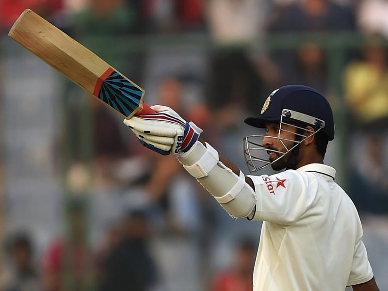 India's Ajinkya Rahane raises his bat as he completes his half-century. (AFP Photo)