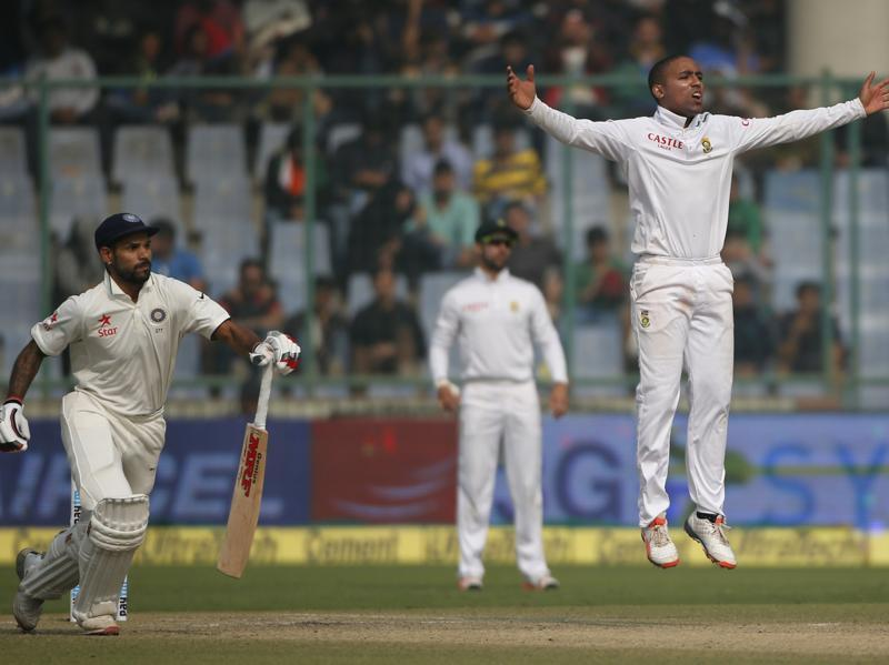 India's Shikhar Dhawan, left , takes off for a single as South Africa's Dane Piedt, right, appeals for his wicket. (AP photo)