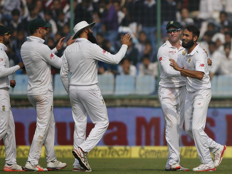 South African bowler Imran Tahir, right, celebrates the dismissal of Cheteshwar Pujara with teammates, from left, Jean-Paul Duminy, Faf du Plessis, Hashim Amla, and AB de Villiers. (AP photo)