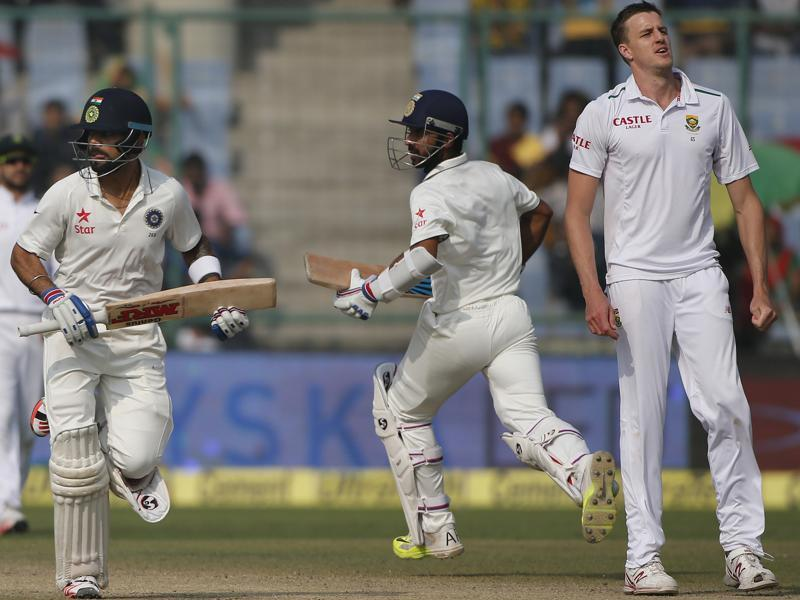 South African bowler Morne Morkel, right watches as Indian batsmen Virat Kohli, left and Ajinkya Rahane, second right run between the wickets. (AP Photo)