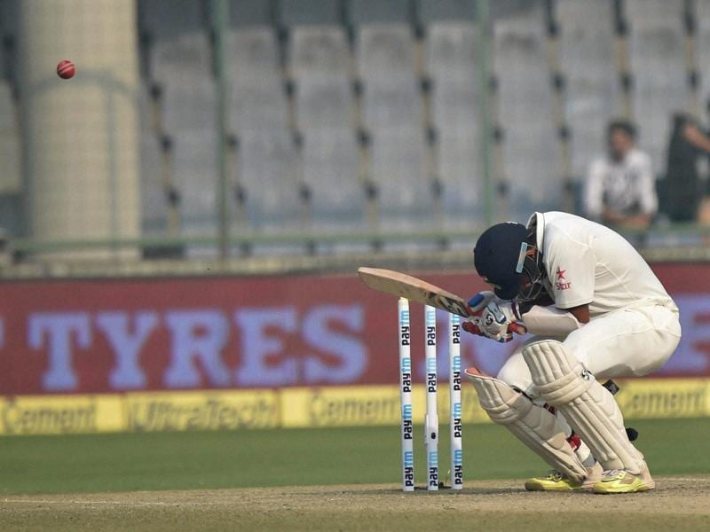 India's Cheteshwar Pujara ducks a bouncer. (PTI photo)