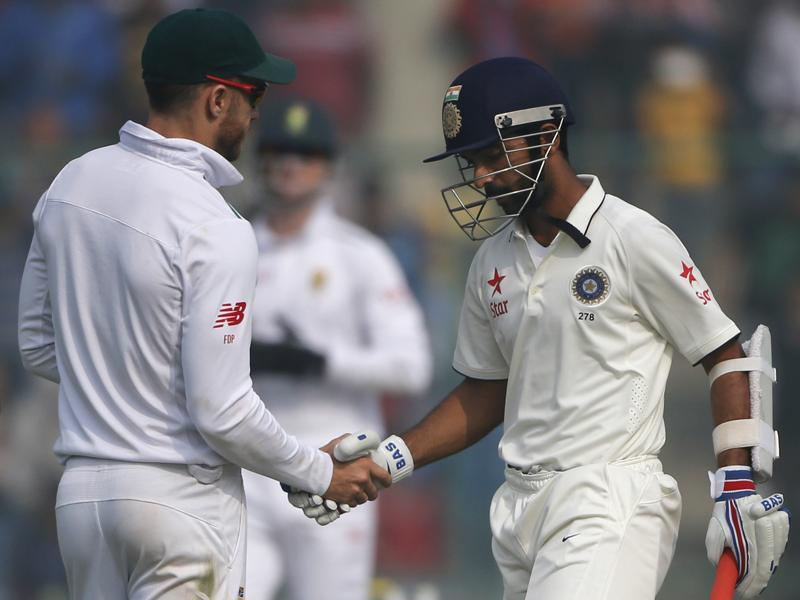 South Africa's Faf du Plessis, left, shakes hands with Ajinkya Rahane after Rahane scored his second century of the match. (AP)