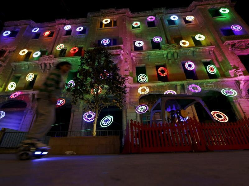 Despite the deadly twin suicide bombings in November and a war in Syria in its neighbourhood, the people of Beirut haven't given up on the spirit of Christmas. A boy rides a two-wheeled self-balancing scooter near to a war-ravaged building decorated for Christmas, in downtown Beirut, Lebanon December 5, 2015. (REUTERS)