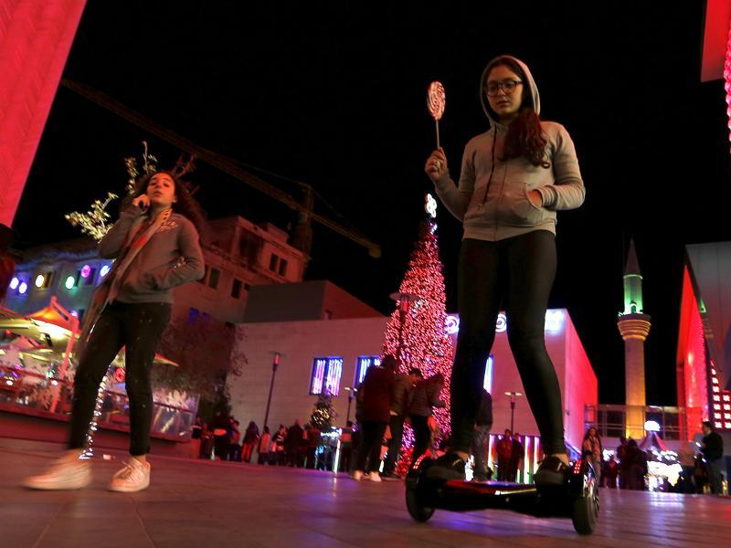 According to Biblical records, Paul and Peter converted Phoenicians (inhabitants of modern-day Lebanon and Syria) to Christianity. A girl rides a two-wheeled self-balancing scooter near a Christmas tree in downtown Beirut, Lebanon December 5, 2015. (REUTERS)