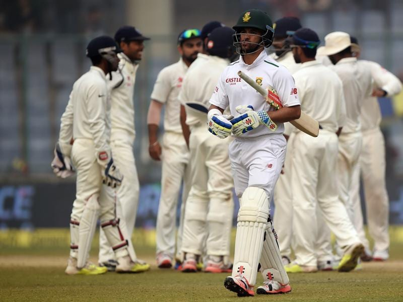 South Africa's JP Duminy walks back as the Indian team celebrates his dismissal by Ravichandran Ashwin. (AFP Photo)