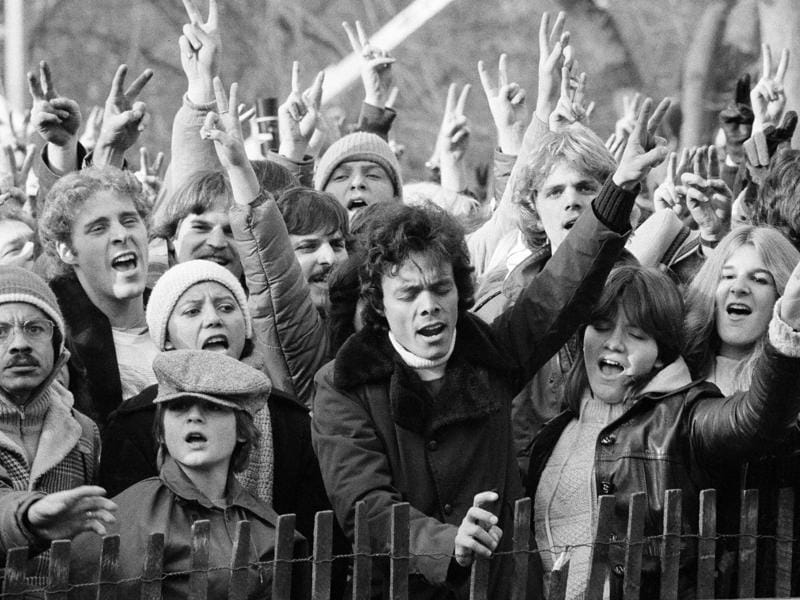 People paying their tribute to Lennon by singing 'Give Peace A Chance' in New York's Central Park on December 14, 1980.  (AP)