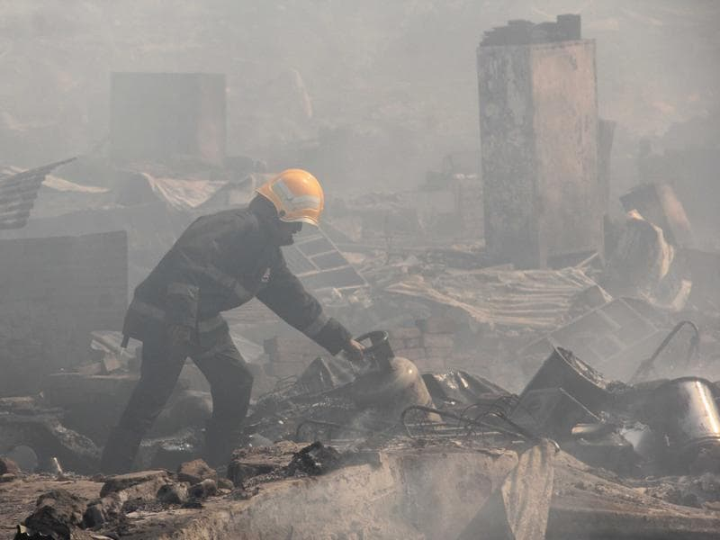 Two people, including a child, were killed and at least 11 others injured after a massive fire broke out at the Damu Nagar slums in Kandivli (East) on Monday afternoon.  (Pramod Thakur/ HT Photo)