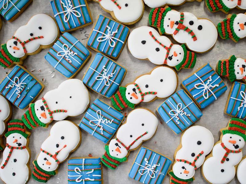 Biscuits shaped and iced in the form of snowmen and presents wait to be packaged at the Biscuiteers biscuit company in south London on December 8, 2015. (AFP)