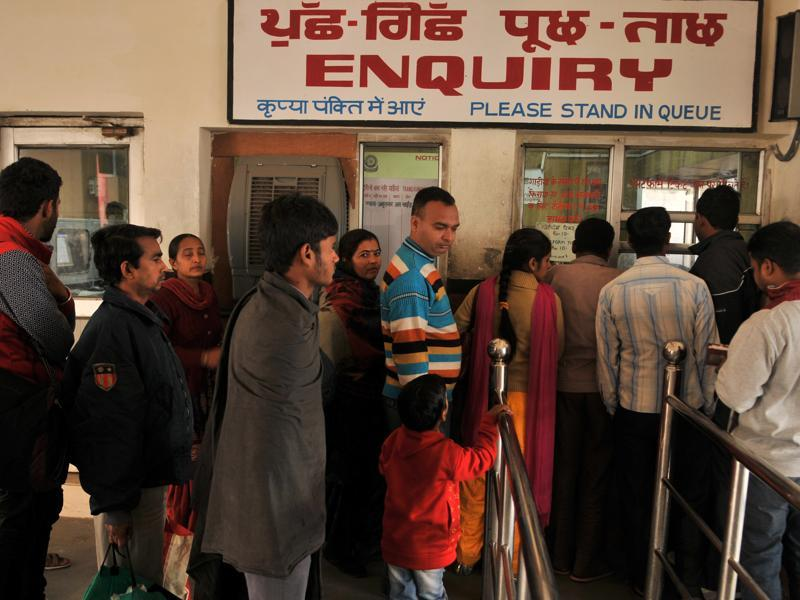 Passengers flock to the train station's  enquiry office to know about the status of their trains.  (Pardeep Pandit/HT Photo)