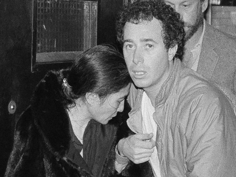 Yoko Ono and record producer David Geffen leave Roosevelt Hospital in New York after the death of her husband, John Lennon on December 9, 1980.  (AP)