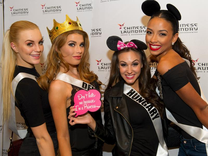 (From left) Miss Sweden 2015 Paulina Brodd, Miss Denmark 2015 Cecilie Wellemberg, Miss Hungary 2015 Nikoletta Nagy and Miss France 2015 Flora Coquerel pose for photos at a Chinese Laundry sponsored event at Zappos, in Las Vegas, Nevada, December 8, 2015.  (REUTERS)