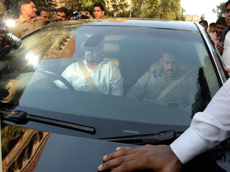 Salman Khan being driven away in a car from Bombay high court in Mumbai on Thursday after the court acquitted him of charges of culpable homicide. The court said the evidence provided by the prosecution was not enough to prove Khan guilty in the 13 year-old hit-and-run case. (AFP)