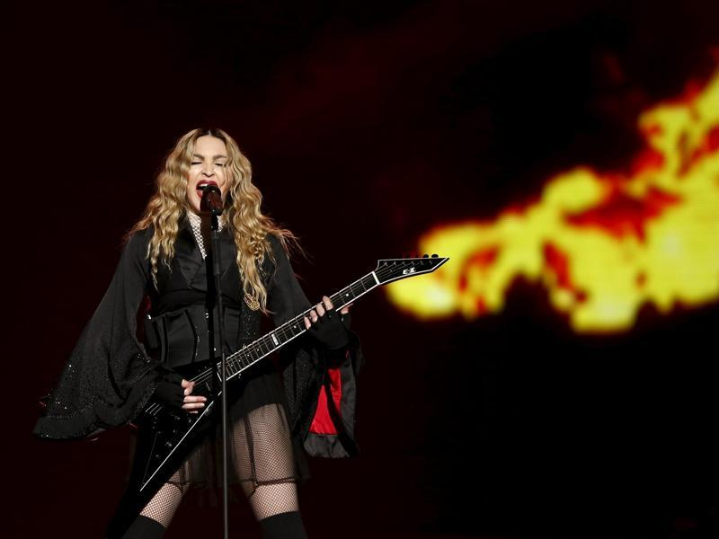 Singer Madonna channels the Doof Warrior from Mad Max during her concert at the AccorHotels Arena in Paris. (REUTERS)