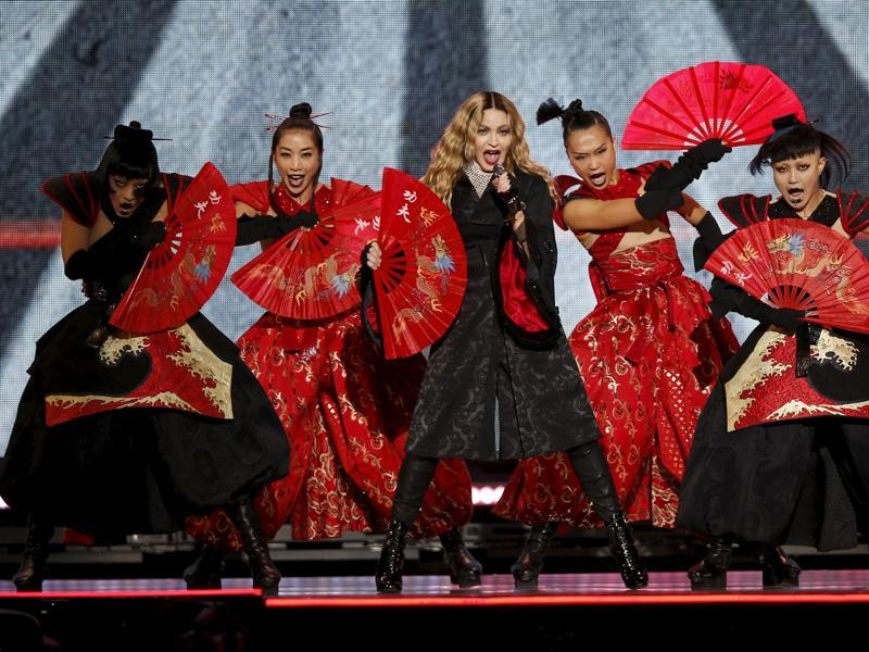Singer Madonna surrounded by fierce, warrior-like performers at her grand Paris gig. (REUTERS)